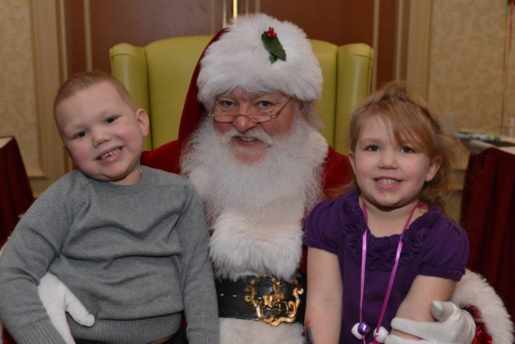 Dana-Farber's Jimmy Fund Clinic patient Thomas Stevenson, 4, and his sister, Madison, 3 visit with Santa Claus at the Jimmy Fund Clinic Winter Festival.