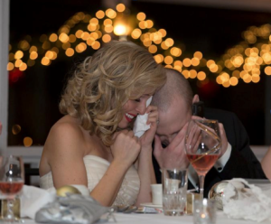 David Lash and his wife, Kate, enjoy a surprise phone call on their wedding night from David's stem-cell donor, who helped save his life. Photo courtesy of CWKelly Photography.