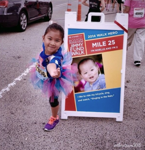 Mia stopped to do a pose and thank an anonymous donor at Mile 25 of the 2014 Boston Marathon Jimmy Fund Walk presented by Hyundai.