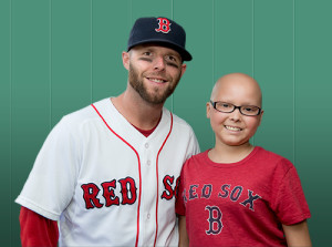 Boston Red Sox Second Baseman and former Rally for the Jimmy Fund spokeplayer, Dustin Pedroia, with Jimmy Fund Clinic patient Janesa.