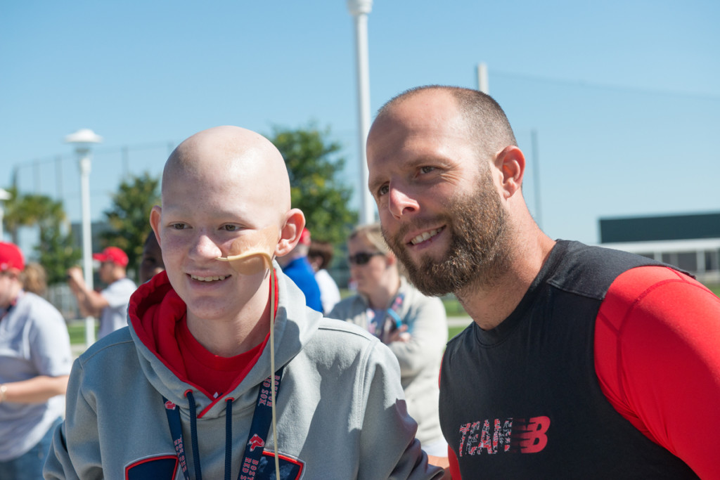 Jimmy Fund Clinic patient, Kyle, and Red Sox player, Dustin Pedroia hang out at JetBlue Park