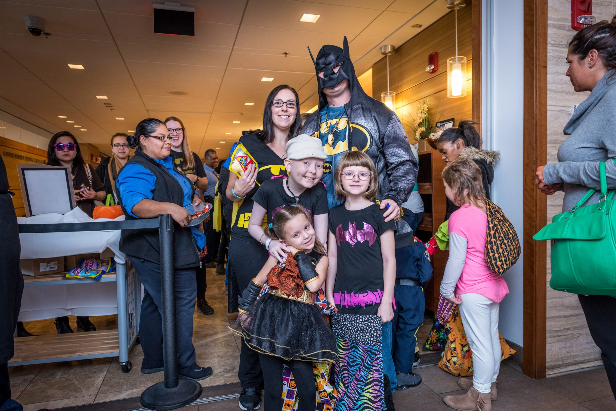 Jimmy Fund Clinic patient Aurora, age 10, trick-or-treats with her Bat-family.