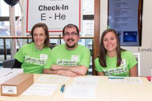Chris Lopez (center) volunteering at the 2015 Dana-Farber Marathon Challenge Pasta Party.