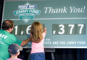 Chris at the 2014 WEEI/NESN Jimmy Fund Radio-Telethon during his most memorable moment as a Jimmy Fund volunteer.