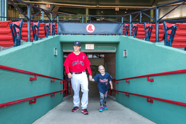 Layla and Brock walk up the ramp to Fenway Park.