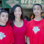 Terell and Javon pose for a photo with their mother at the 2012 WEEI/NESN Jimmy Fund Radio-Telethon presented by Arbella Insurance Foundation