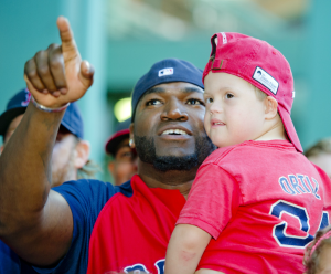 David Ortiz shares a moment with a pediatric patient during the 2013 WEEI/NESN Jimmy Fund Radio-Telethon.