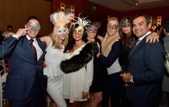 Guests attend the UnMask Cancer annual fundraiser to support patient care and cancer research at Dana-Farber Cancer Institute at the Mandarin Oriental Hotel on October 22.