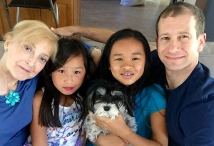 Esther and Jon Zaff, with their daughters Gabriella (left), Eliana, and their dog, Effie, made a gift to Dana-Farber in their will to recognize the outstanding care Esther has received.
