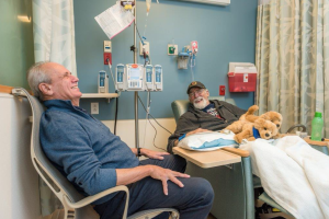 "Infusion patient Joe Pryor shared a laugh and a great Ted Williams story with Lucchino during their visit. Pryor had worn his Red Sox cap and ""2016 AL East Champions"" tee-shirt to Dana-Farber that day, not knowing he would meet Lucchino."
