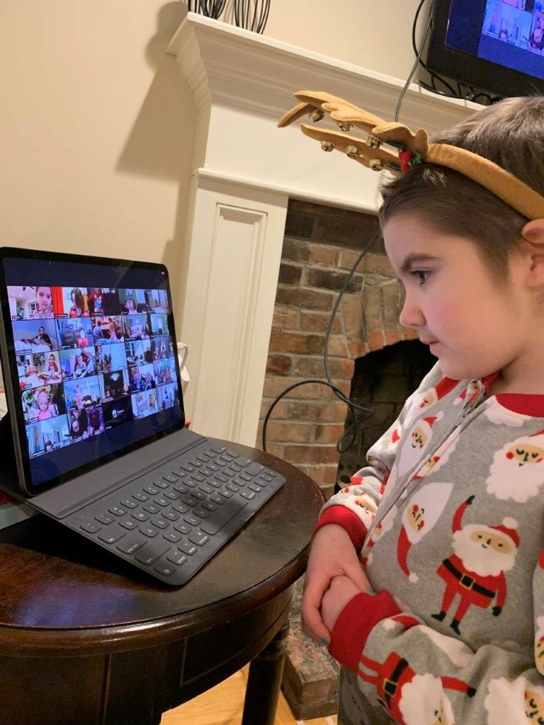 Aileen, 6, joins fellow patients for a virtual visit from Santa.