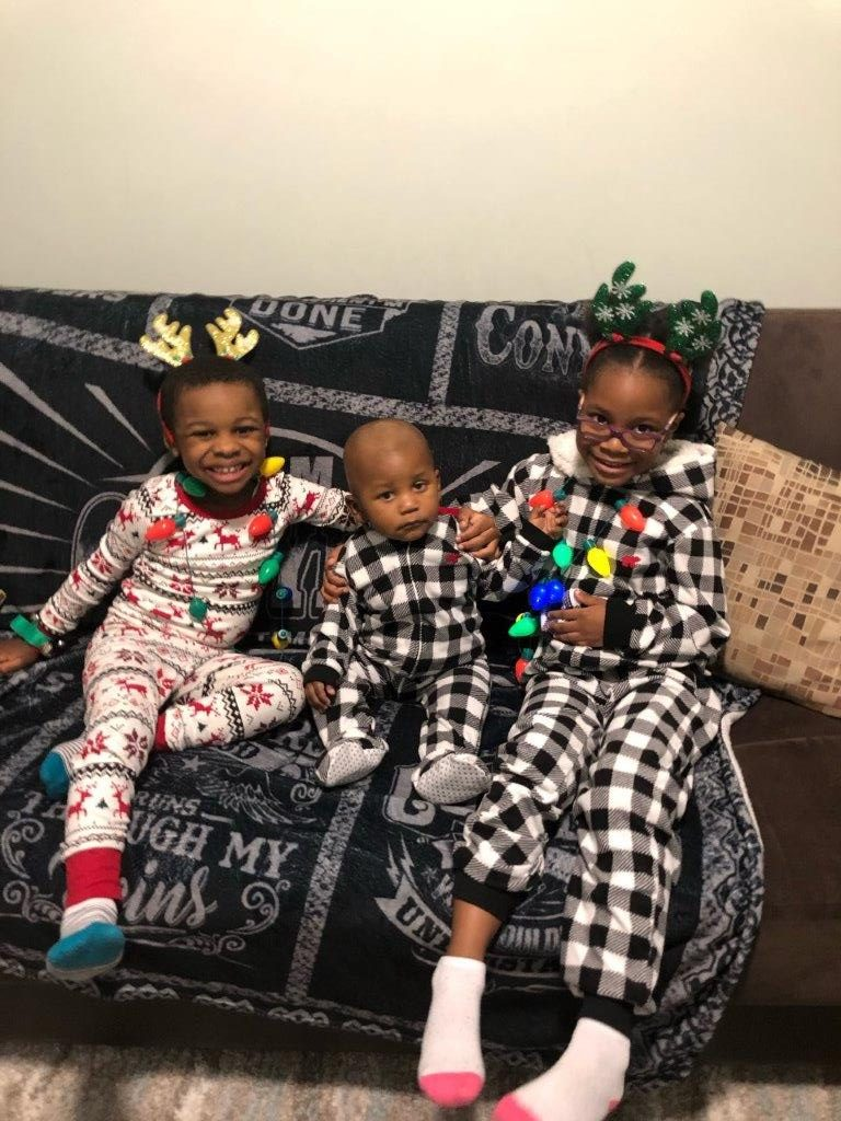 Elijah, who turns 1 on December 26, (center), and his siblings, Miles and Kayla, enjoyed a festive night at home.
