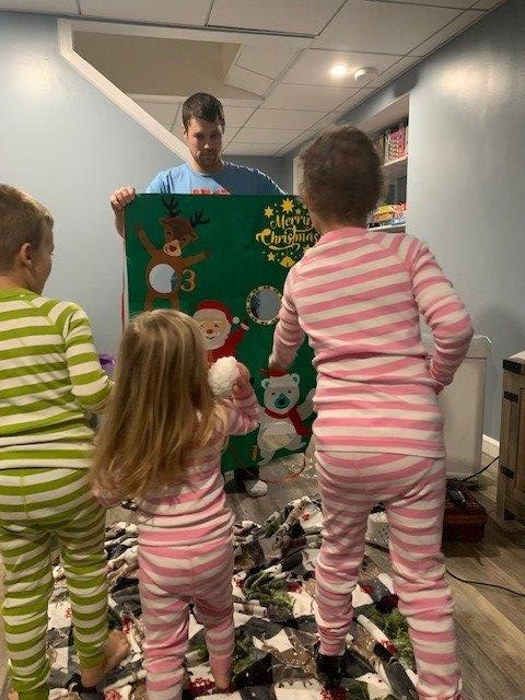 Maddie, 7, (right) played festive games with her family after Santa's visit.