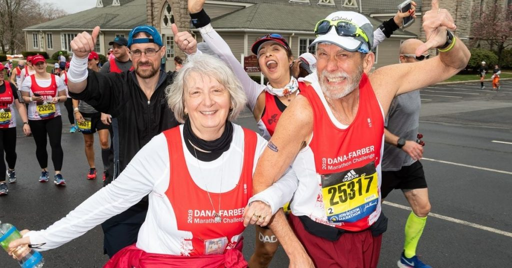 Cathy (left) at the start of the 2019 Boston Marathon® with fellow 2019 DFMC Runner Jerry